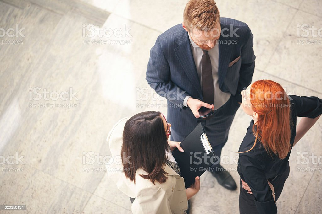 Business people in the lobby talking overhead shot stock photo