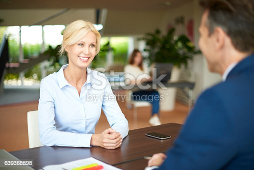 625740042 istock photo Business people in the office consulting 639368898