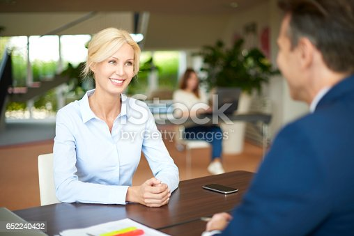 istock Business people in the office consulting 652240432