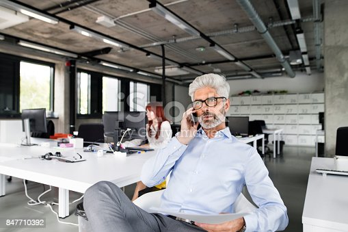 913346608 istock photo Business people in the office working together. 847710392