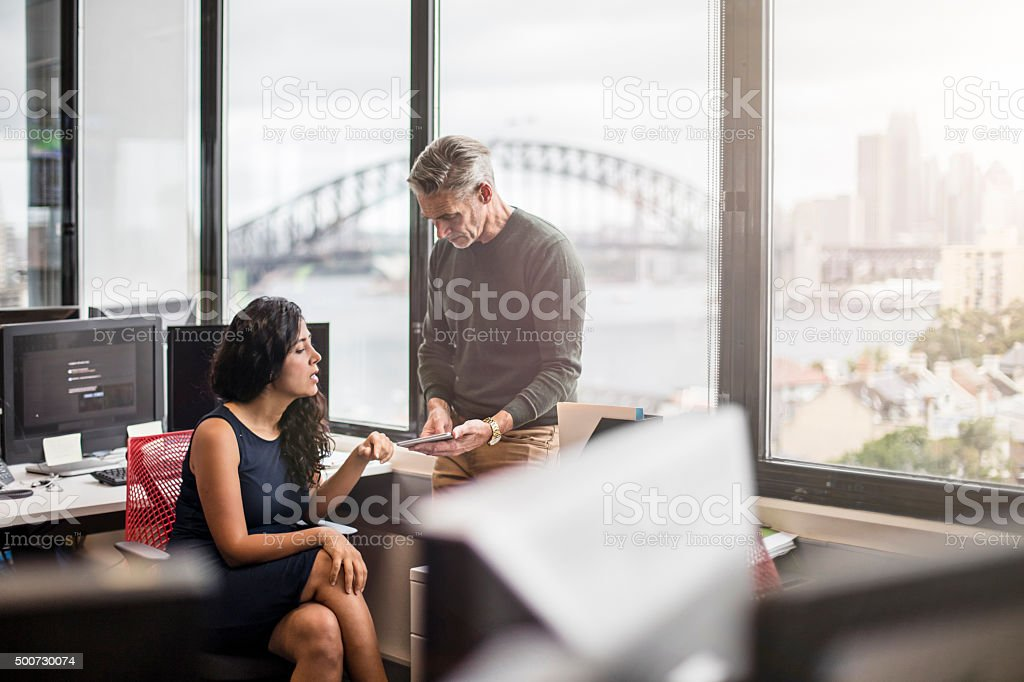 Business people in the office working with a digital tablet stock photo
