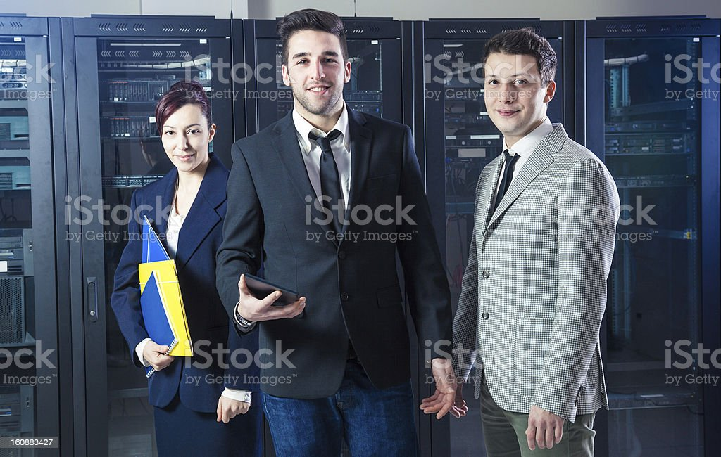Business people in the server room royalty-free stock photo