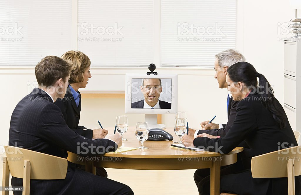 Business People in Video Meeting royalty-free stock photo