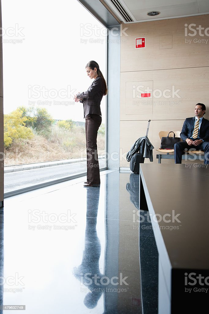 Business people in waiting area stock photo
