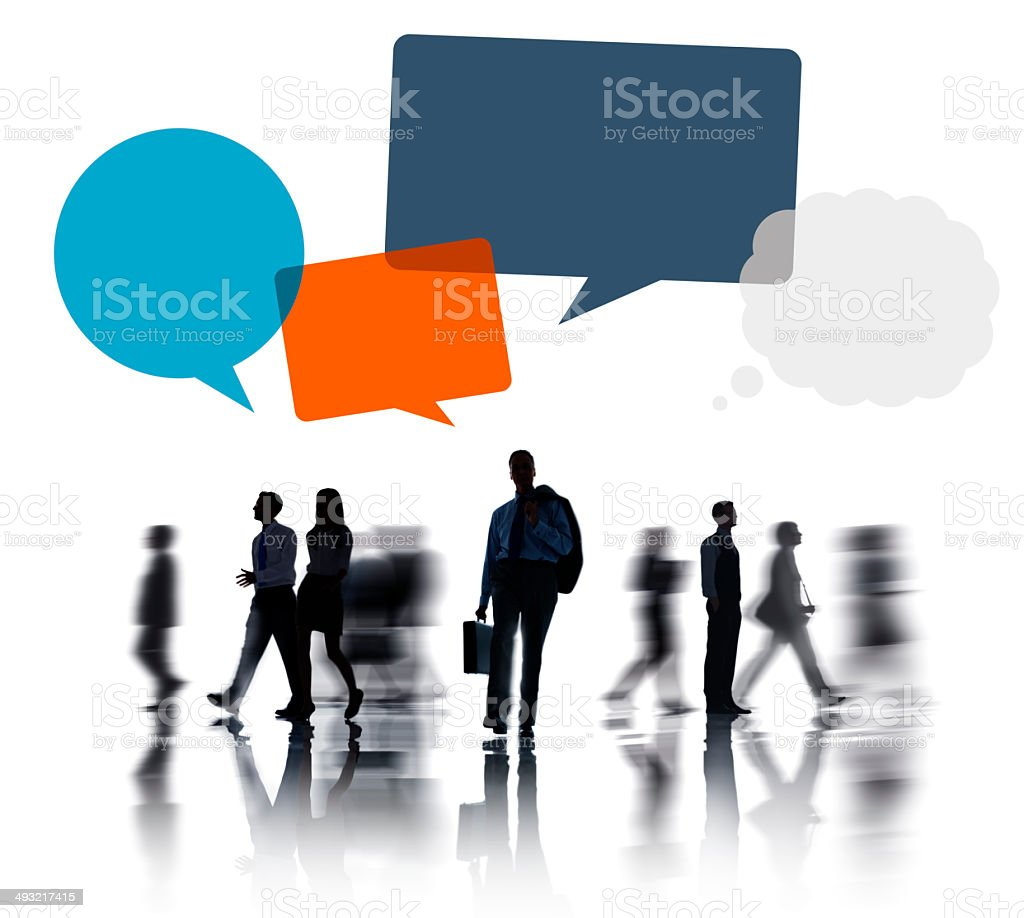 Business People Isolated on White and Speech Bubble Above stock photo