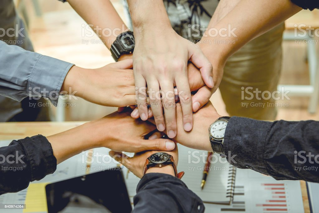 Business people join hands for teamwork. stock photo
