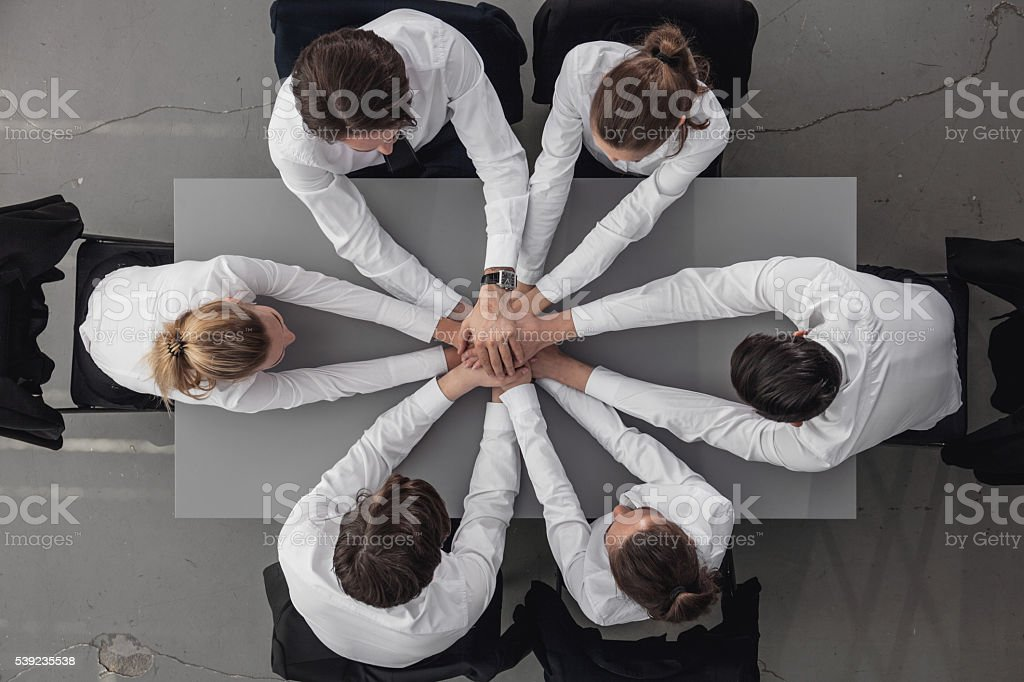 Business people joining hands royalty-free stock photo