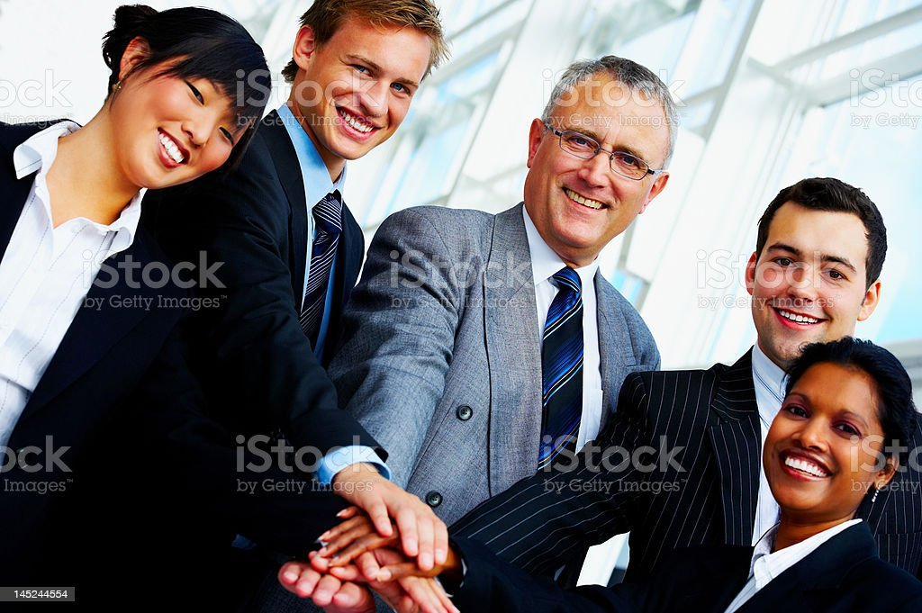 Business people joining their hands royalty-free stock photo