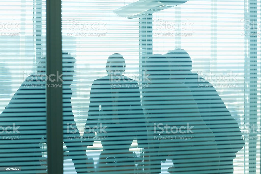 Business people leaning on table in meeting royalty-free stock photo