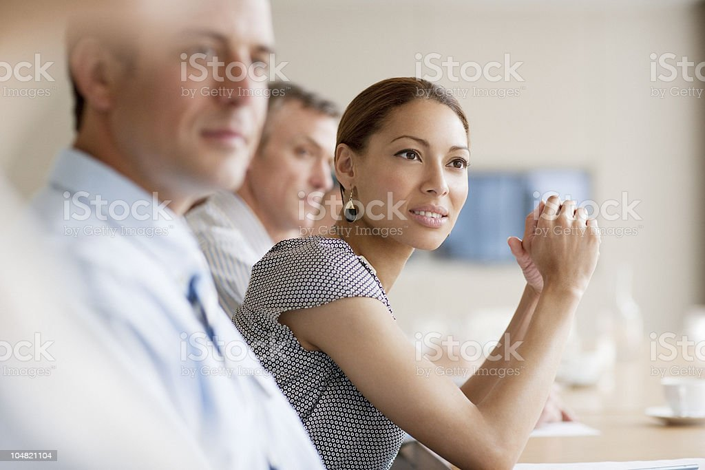 Business people listening in meeting stock photo