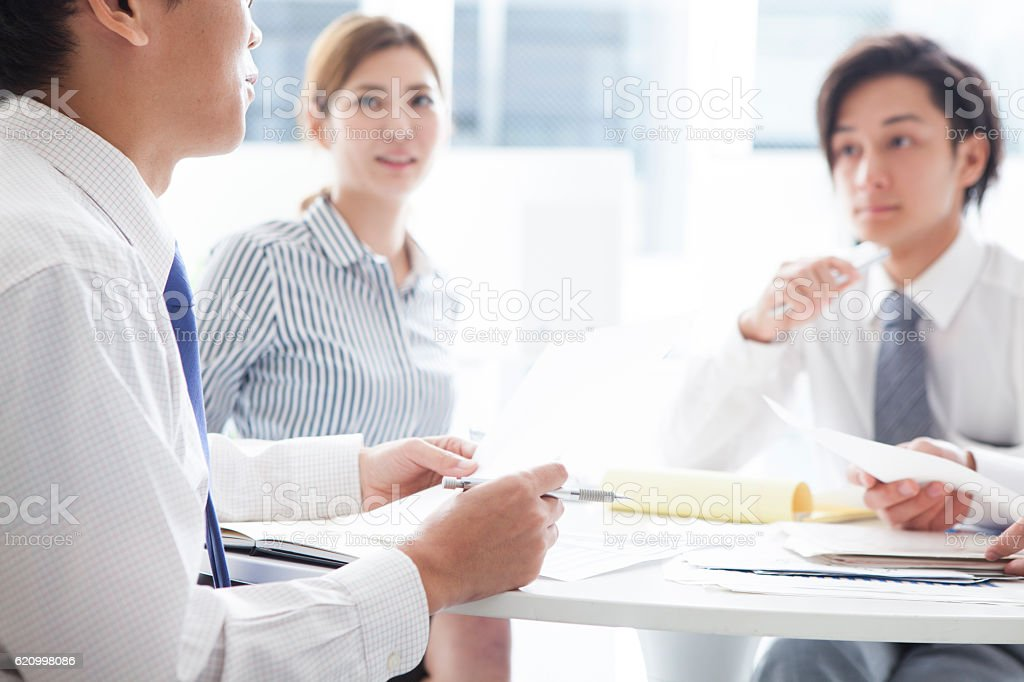 Business people listening to the opinion of the boss during a meeting