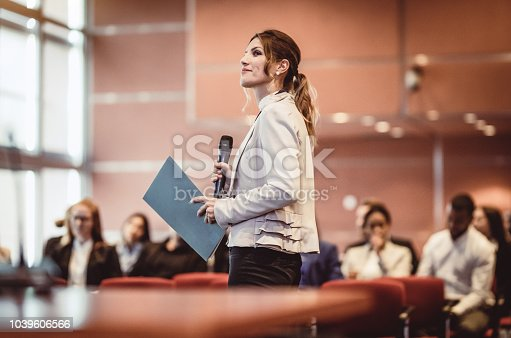 istock Business People Listening to the Speaker at a Conference 1039606566