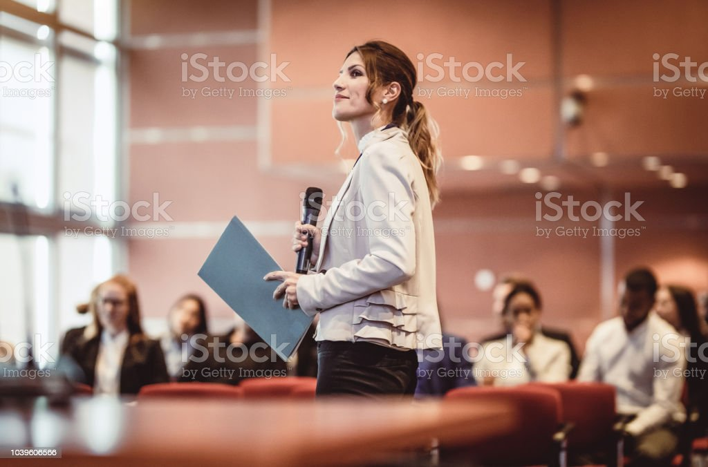 Business People Listening to the Speaker at a Conference stock photo