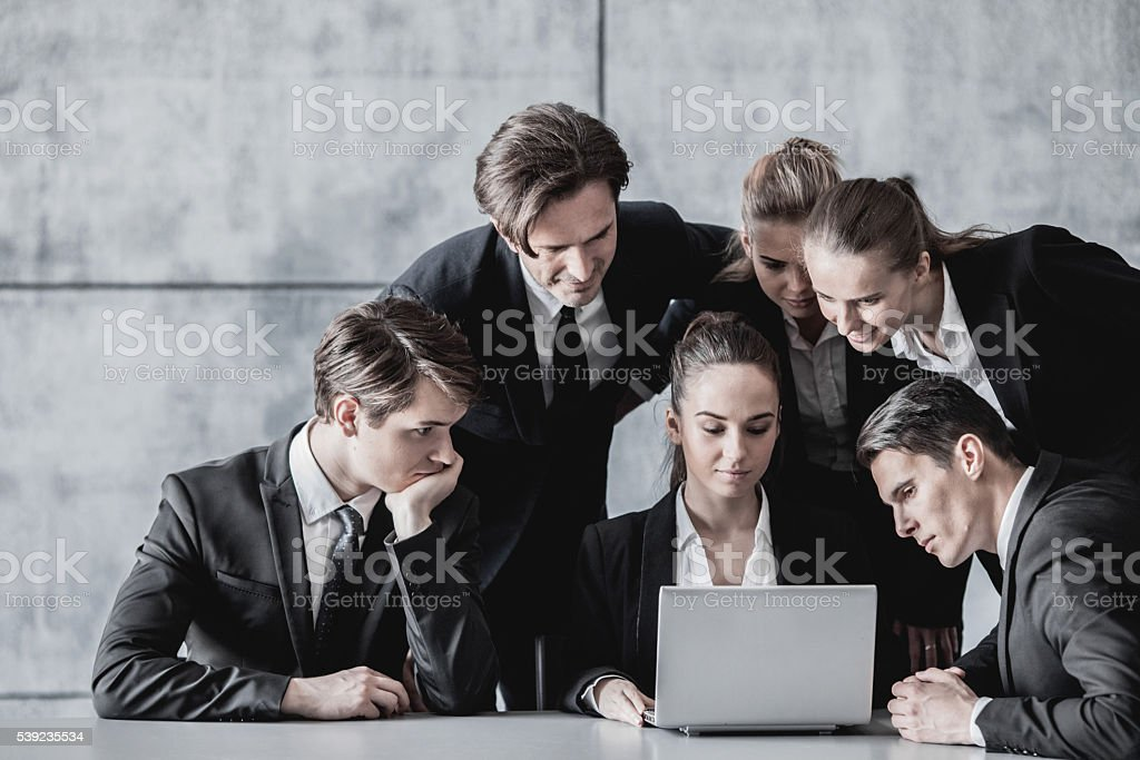 Business people look at laptop royalty-free stock photo
