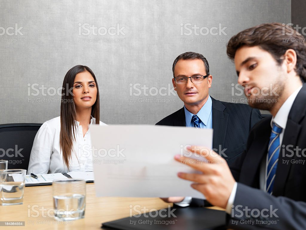 Business people looking a document royalty-free stock photo