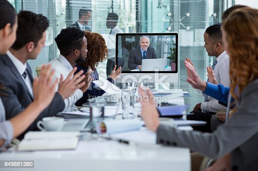 istock Business people looking at a screen during a video conference 649881380