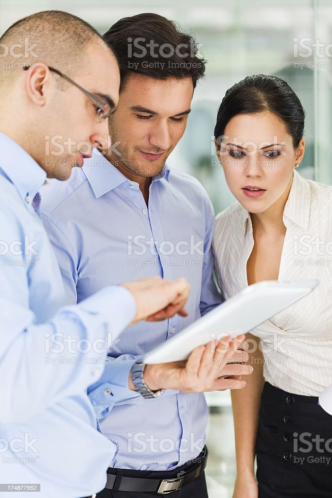 Business people looking at digital tablet royalty-free stock photo