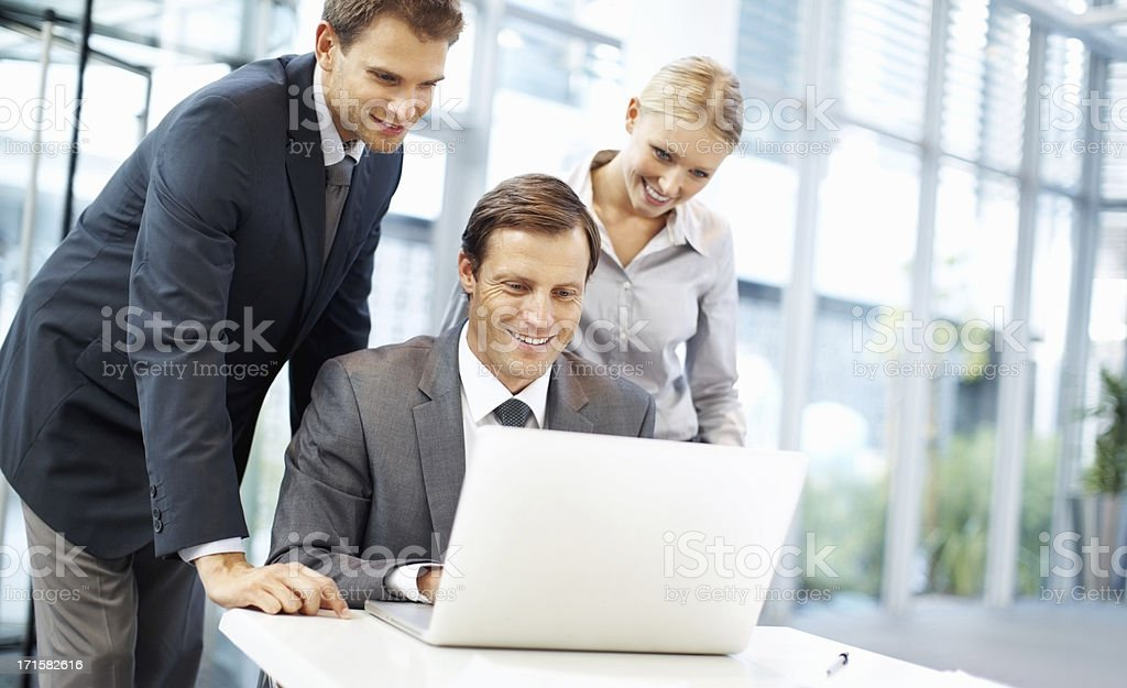 Business people looking at laptop screen royalty-free stock photo