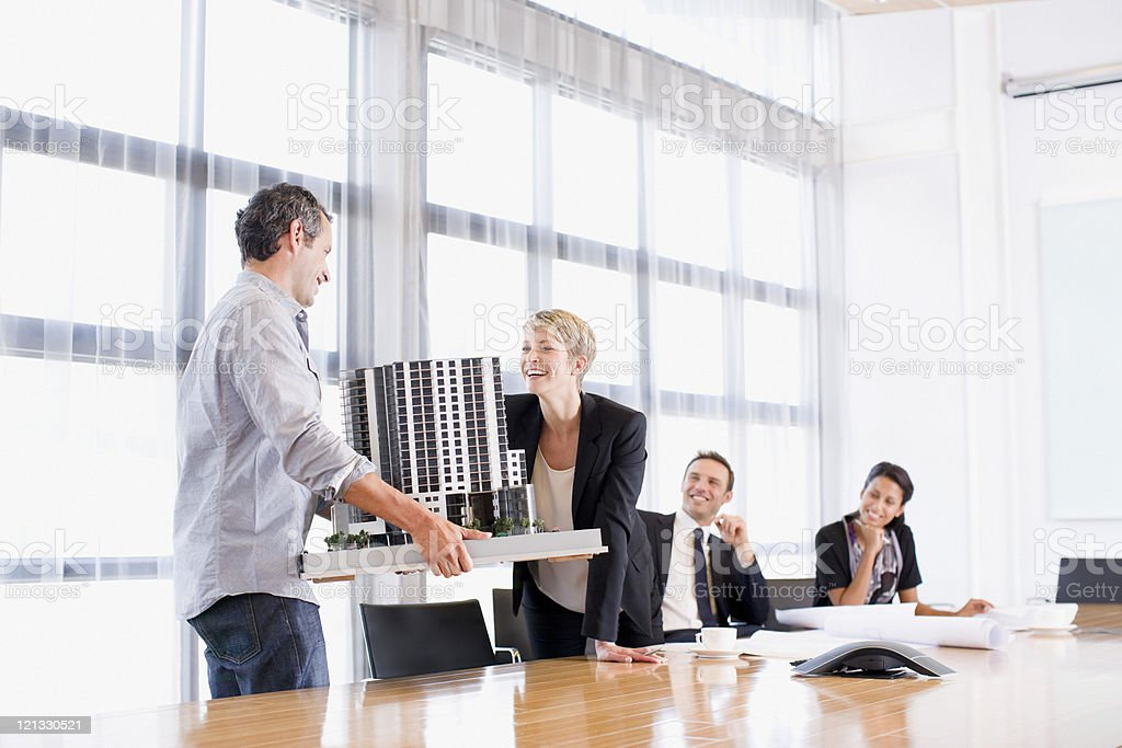 Business people looking at model building royalty-free stock photo
