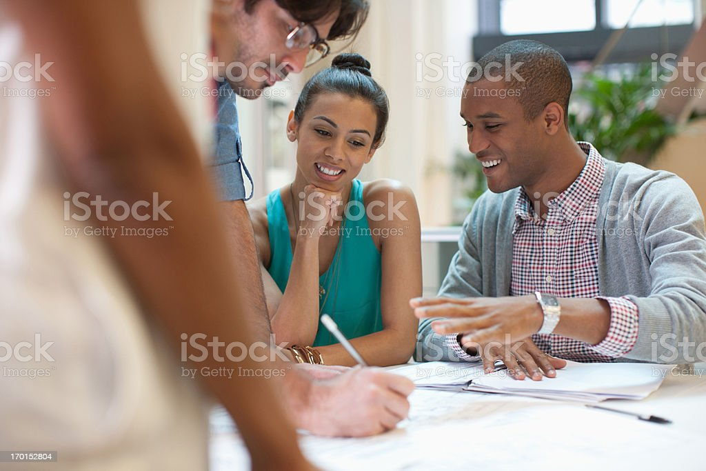 Business people looking at paperwork in meeting royalty-free stock photo