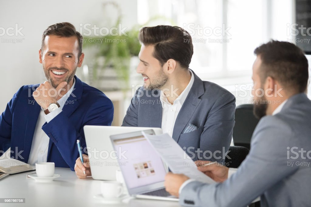 Business people looking happy during the meeting Business people looking happy during the meeting. Corporate professionals smiling in meeting. Adult Stock Photo