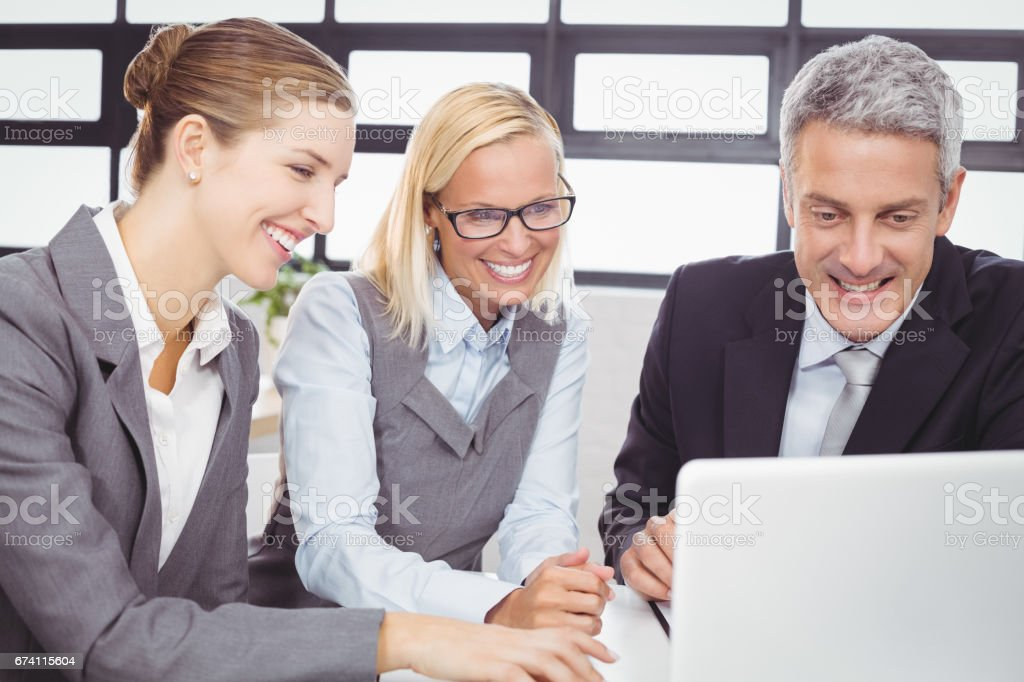 Business people looking in laptop during meeting royalty-free stock photo