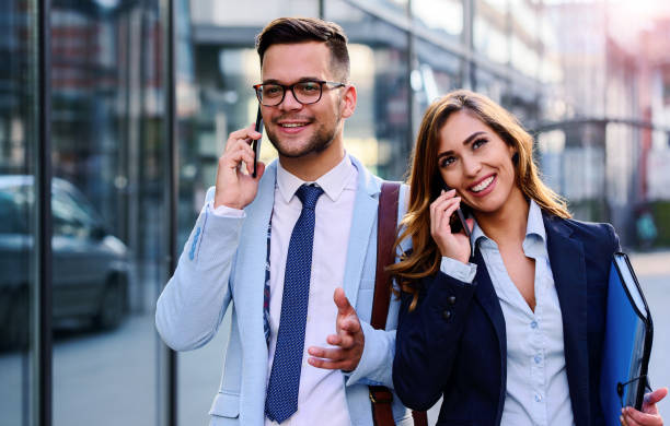 Business people makes a phone call in front of the corporation. Business, lifestyle concept stock photo