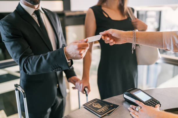 Business people makes card payment at check-in at reception. stock photo