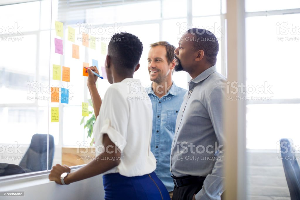 Business people making strategy in creative office stock photo