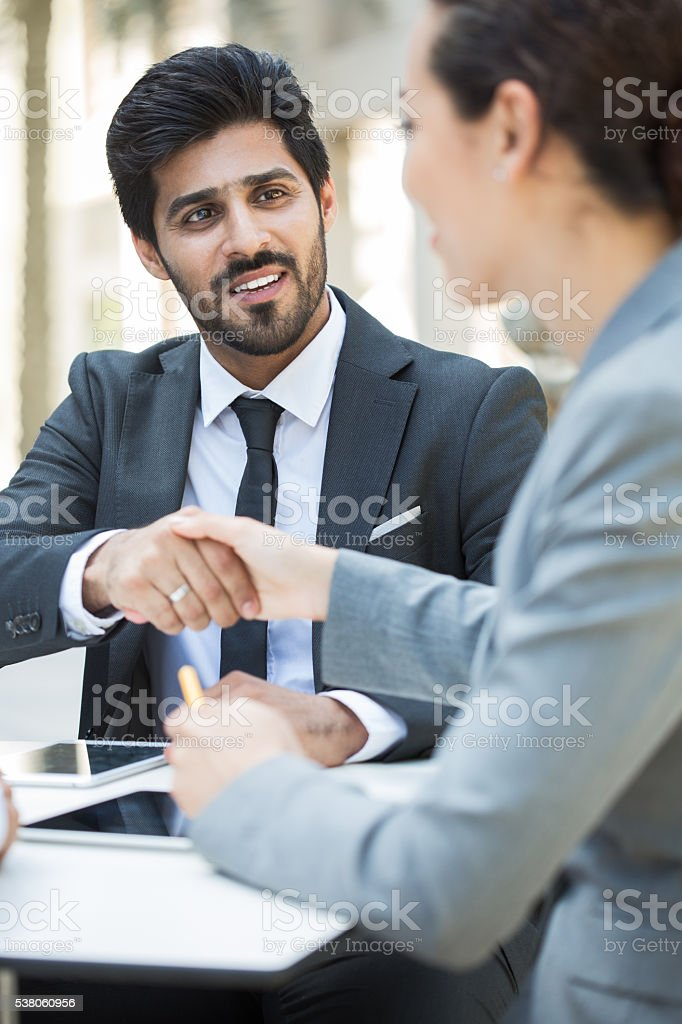 Business people meet outdoors in Dubai. stock photo