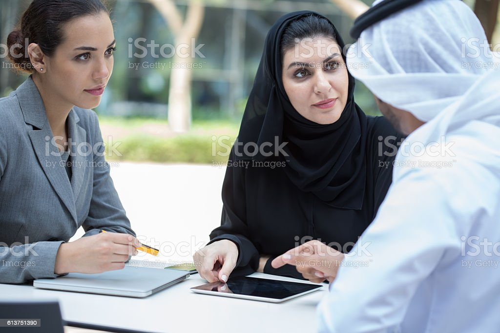 Business people meet outdoors in Dubai. stock photo