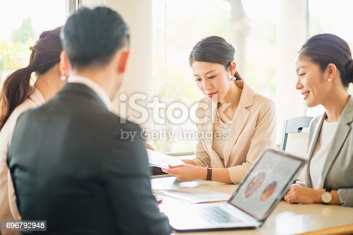 istock Business people meeting at cafe 696792948