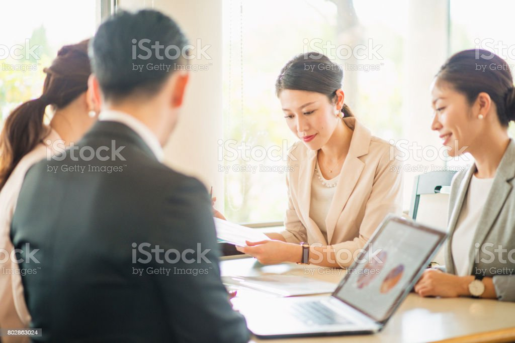 Business people meeting at cafe stock photo