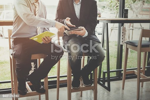 istock Business people meeting at working with financial and a tablet 945174240