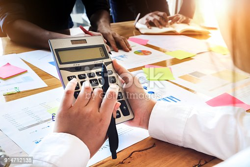 881542122istockphoto Business People Meeting Corporate Communication with using calculator, pen, notebook and graph chart in at office. Teamwork Concept 914712138
