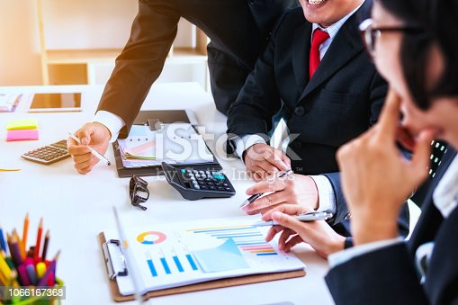 951092116istockphoto Business people meeting corporate group for discussing the charts and graphs in meeting room. Teamwork successful Meeting Workplace strategy Concept. 1066167368
