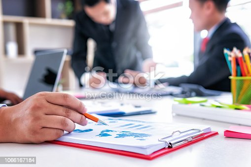 951092116istockphoto Business people meeting corporate group with analyzing financial data investment in office.Teamwork successful meeting workplace strategy concept 1066167184
