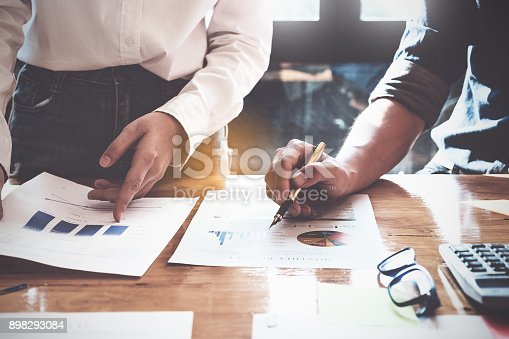 istock Business People Meeting Design Ideas Concept. Group of Investor diverse brainstorm and pointing at laptop computer on wooden desk. 898293084