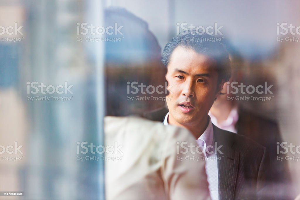 Business people having a meeting Japan and viewed through an office...