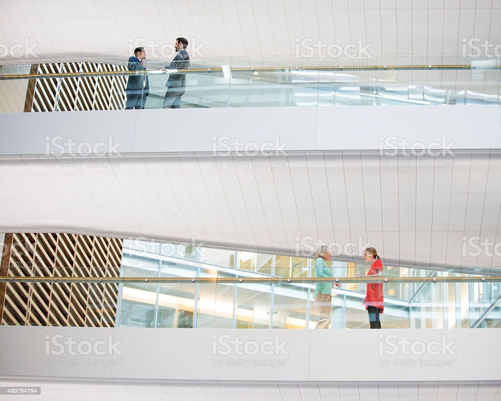 Business people meeting in modern office on different floors stock photo