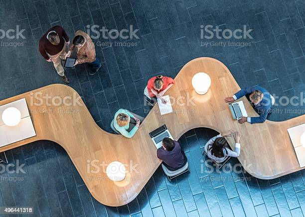 Business People Meeting In Modern Office View From Above Stock Photo - Download Image Now