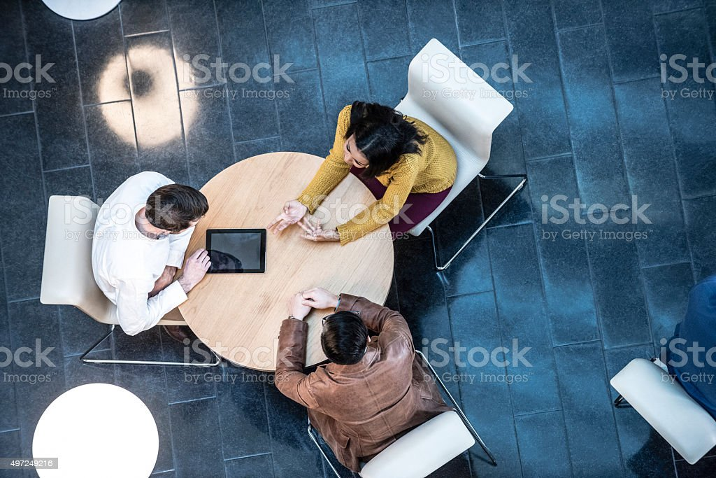 Business people meeting in modern office, view from above - Royalty-free 2015 Stock Photo