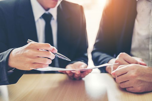 Business People Meeting Negotiating A Contract Between Two Colleagues Stock Photo - Download Image Now