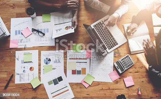 istock Business People Meeting using laptop computer, calculator, notebook, stock market chart paper for analysis Plans to improve quality next month. Conference Discussion Corporate Concept 905819004