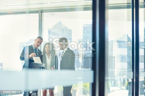 istock Business people meeting with a digital tablet. 1020236212