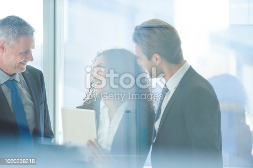 istock Business people meeting with a digital tablet 1020236216