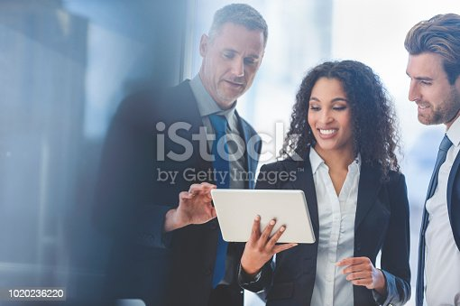 istock Business people meeting with a digital tablet. 1020236220