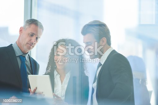 istock Business people meeting with a digital tablet 1020236222