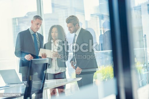 istock Business people meeting with a digital tablet. 1020236228