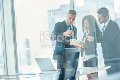 istock Business people meeting with a digital tablet. 1020236230